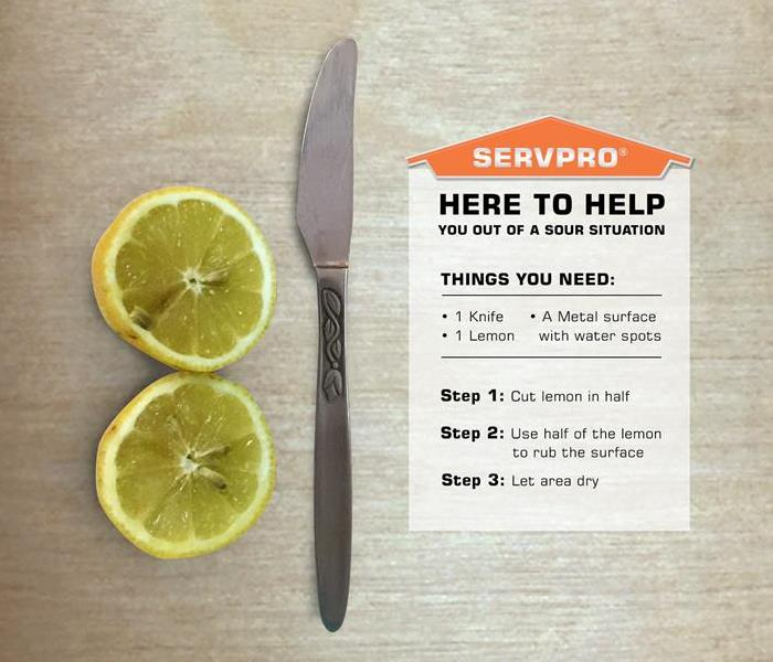 Lemon and a knife to remove water spots on metal surfaces