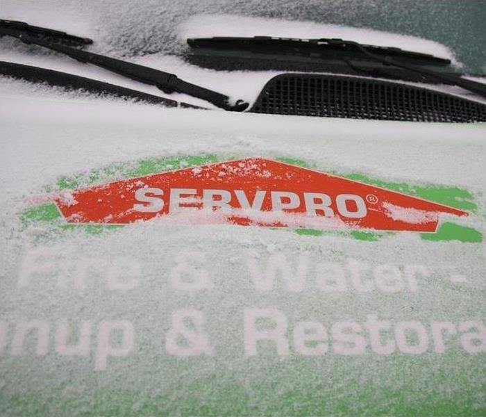 servpro green vehicle with snow